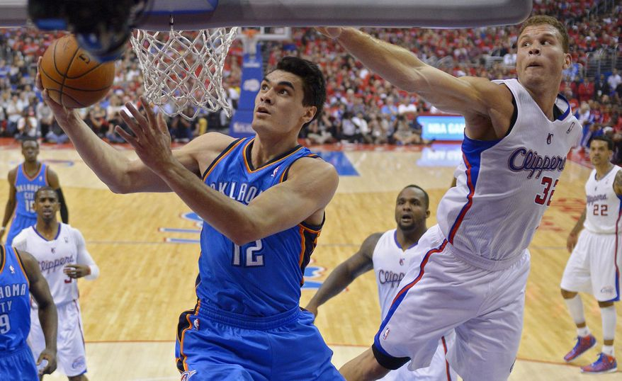 Oklahoma City Thunder center Steven Adams, left, of New Zealand, puts up a shot as Los Angeles Clippers forward Blake Griffin, right, defends in the first half of Game 6 of the Western Conference semifinal NBA basketball playoff series, Thursday, May 15, 2014, in Los Angeles. (AP Photo/Mark J. Terrill)