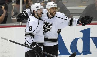 Los Angeles Kings right wing Marian Gaborik, right, of Slovakia, celebrates his goal with defenseman Drew Doughty during the second period in Game 7 of an NHL hockey second-round Stanley Cup playoff series against the Anaheim Ducks, Friday, May 16, 2014, in Anaheim, Calif. (AP Photo/Mark J. Terrill)
