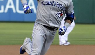 Toronto Blue Jays' Jose Bautista runs the bases after hitting a solo home run during the first inning of a baseball game against the Texas Rangers in Arlington, Texas, Saturday, May 17, 2014. (AP Photo/LM Otero)