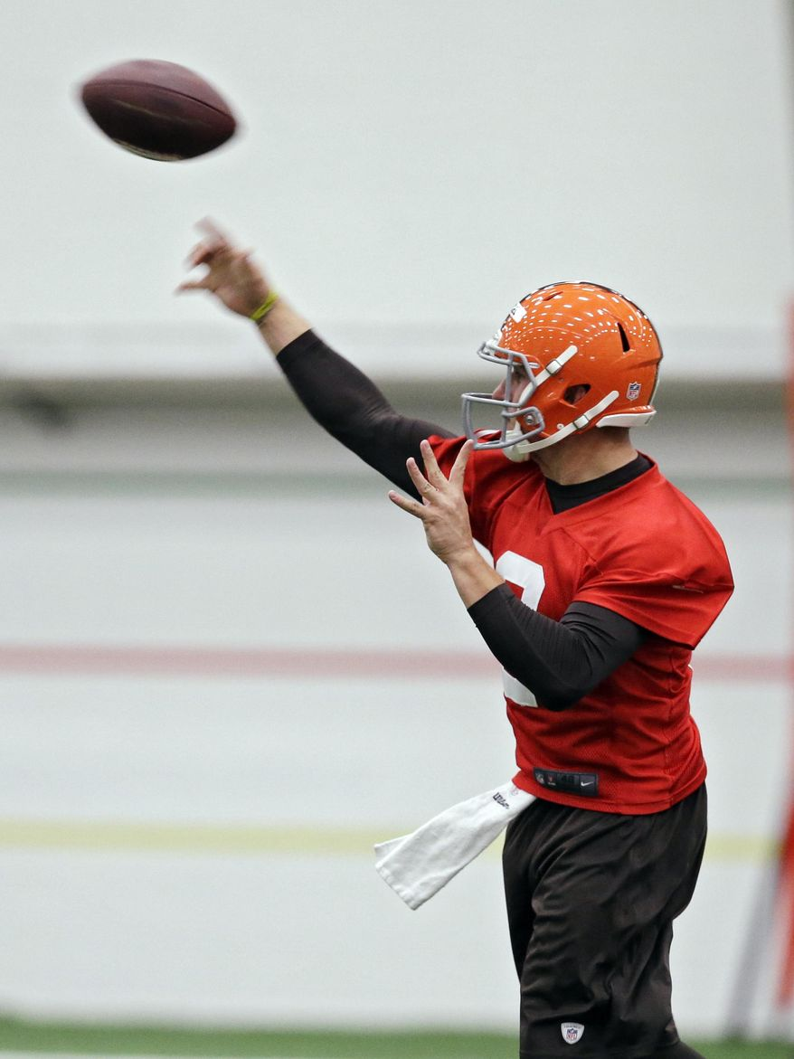 Cleveland Browns quarterback Johnny Manziel passes during a rookie minicamp practice at the NFL football team's facility in Berea, Ohio Saturday, May 17, 2014. (AP Photo/Mark Duncan)