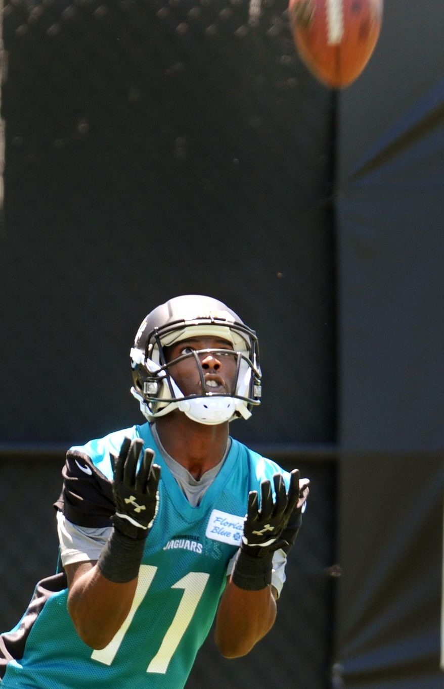 Newly drafted Jacksonville Jaguars wide receiver Marqise Lee hauls in a kick during the NFL football team's rookie minicamp Friday, May 16, 2014, in Jacksonville, Fla. (AP Photo/The Florida Times-Union, Will Dickey)