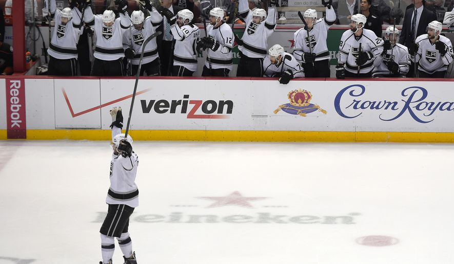 Los Angeles Kings defenseman Drew Doughty, lower left, and members of his team celebrate a goal by left wing Tanner Pearson during the third period in Game 7 of an NHL hockey second-round Stanley Cup playoff series against the Anaheim Ducks, Friday, May 16, 2014, in Anaheim, Calif. The Kings won 6-2. (AP Photo/Mark J. Terrill)
