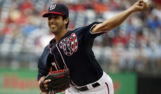 Washington Nationals starting pitcher Gio Gonzalez (47) throws during the first inning of a baseball game against the New York Mets at Nationals Park Saturday, May 17, 2014, in Washington. (AP Photo/Alex Brandon)