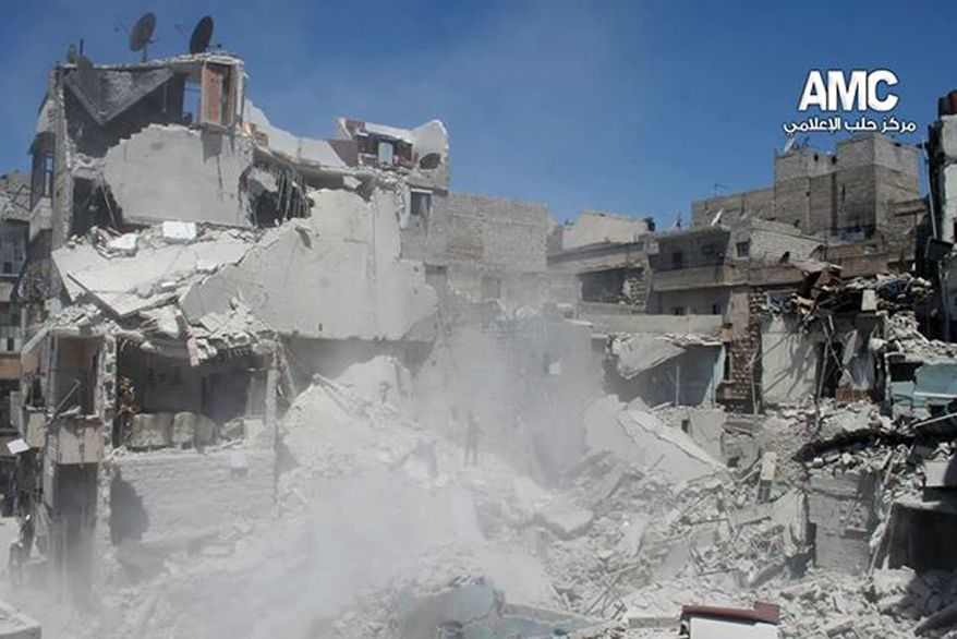 This photo provided by the anti-government activist group Aleppo Media Center (AMC), which has been authenticated based on its contents and other AP reporting, shows buildings which were destroyed from a Syrian government airstrike in Aleppo, Syria, Saturday, May. 17, 2014. The United Nations chief has condemned a cut in water supplies in the northern Syrian city of Aleppo that he said has deprived at least 2.5 million people of access to potable water. (AP Photo/Aleppo Media Center AMC)