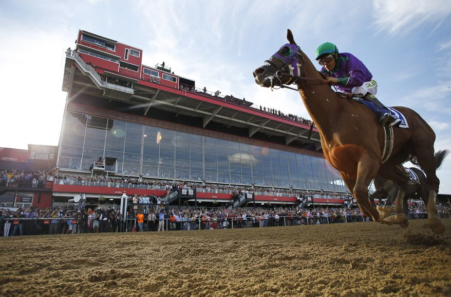 California Chrome, ridden by jockey Victor Espinoza, wins the 139th Preakness Stakes horse race at Pimlico Race Course, Saturday, May 17, 2014, in Baltimore.  (AP Photo/Matt Slocum)