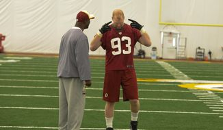 Washington Redskins linebacker Trent Murphy, a second-round draft pick, gets instruction from coaches at the team's rookie minicamp on Saturday morning at Redskins Park.
