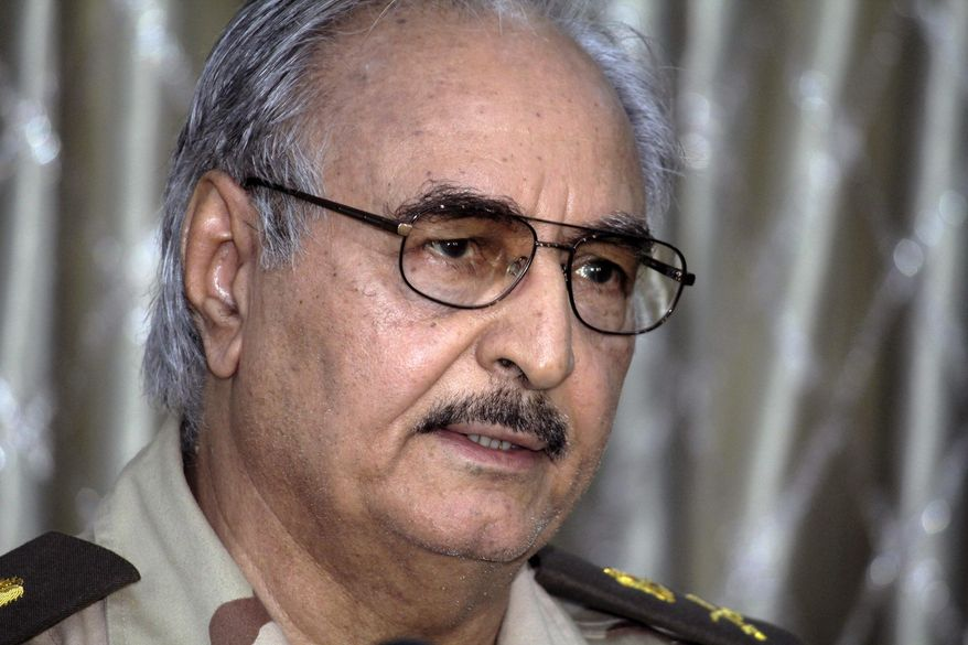 In this Saturday, May 17, 2014 photo, Libyan Gen. Khalifa Hifter addresses a press conference in Benghazi, Libya. The death toll from fighting over the weekend in Libya's eastern city of Benghazi between troops loyal to Hifter, a rogue general, and Islamist militias has risen to at least 70, the Health Ministry said on Sunday. In a statement late Saturday, Libya's interim prime minister, parliament speaker and the head of military warned Hifter against further pursuing his offensive and threatened the troops cooperating with him. (AP Photo/Mohammed el-Shaiky)
