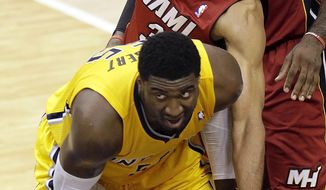Indiana Pacers center Roy Hibbert, left, is fouled by Miami Heat forward Shane Battier during the second half of Game 1 of the Eastern Conference finals NBA basketball playoff series, Sunday, May 18, 2014, in Indianapolis. (AP Photo/AJ Mast)