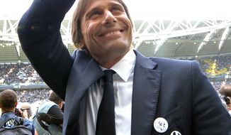 Juventus coach Antonio Conte greets supporters prior to a Serie A soccer match between Juventus and Cagliari at the Juventus stadium, in Turin, Italy, Sunday, May 18, 2014. (AP Photo/Massimo Pinca)