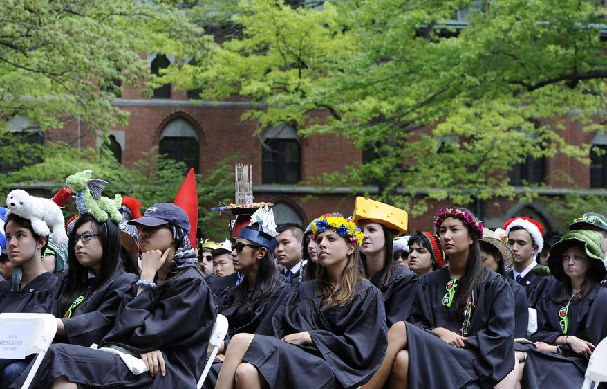 Students listen as Secretary of State John Kerry delivers the Class Day address at Yale University, Sunday, May 18, 2014, in New Haven, Conn. (AP Photo/Jessica Hill)