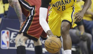 Indiana Pacers center Ian Mahinmi (28) takes the ball down court as Miami Heat forward Chris Andersen, rear, recovers during the first half of Game 1 of the Eastern Conference finals NBA basketball playoff series Sunday, May 18, 2014, in Indianapolis.  (AP Photo/Darron Cummings)