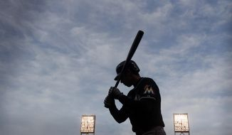 Miami Marlins' Christian Yelich waits on deck for his turn at bat during the fourth inning of a baseball game against the San Francisco Giants on Saturday, May 17, 2014, in San Francisco. (AP Photo/Marcio Jose Sanchez)