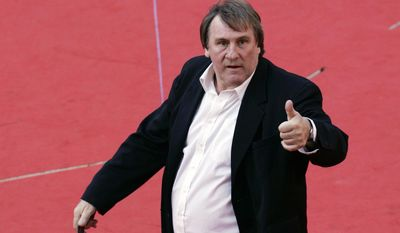 "FILE - In this Sunday, Oct. 21, 2007 file photo, French actor Gerard Depardieu poses for photographers on the red carpet of the Rome Film Festival. Gerard Depardieu was in Cannes on Saturday, May 18, 2014 for a screening of his hotly anticipated film ""Welcome To New York,"" about disgraced former International Monetary Fund chief Dominique Strauss-Khan. (AP Photo/Riccardo De Luca, File)"