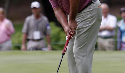 John Cook putts during the final round at the Champions Tour Regions Tradition golf tournament on Sunday, May 18, 2014, in Birmingham, Ala. (AP Photo/Butch Dill)