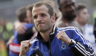 Hamburg's Rafael van der Vaart of the Netherlands celebrates after winning  the relagation play-offs between Greuther Fuerth and Hamburger SV in Fuerth, Germany, Sunday, May 18, 2014.  Hamburg played 1-1 in Fuerth and remains in the first division.  (AP Photo/Matthias Schrader)