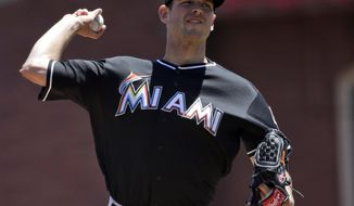 Miami Marlins starting pitcher Jacob Turner throws to the San Francisco Giants during the first inning of a baseball game on Sunday, May 18, 2014, in San Francisco. (AP Photo/Marcio Jose Sanchez)
