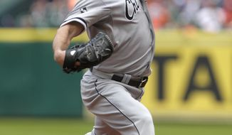 Chicago White Sox pitcher John Danks throws during the first inning of a baseball game against the Houston Astros, Sunday, May 18, 2014, in Houston. (AP Photo/Patric Schneider)