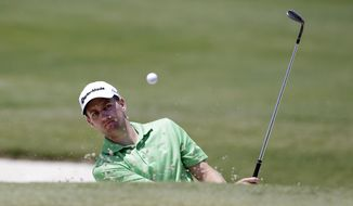 Brendon Todd hits out of a bunker on the second green that would sink for a birdie during the final round of the Byron Nelson Championship golf tournament, Sunday, May 18, 2014, in Irving, Texas. (AP Photo/Tony Gutierrez)