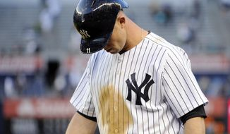 New York Yankees' Brett Gardner walks to the dugout after grounding out for the final out as the Pittsburgh Pirates defeated the Yankees, 5-3 in the second game of a baseball double-header Sunday, May 18, 2014, at Yankee Stadium in New York. (AP Photo/Bill Kostroun)