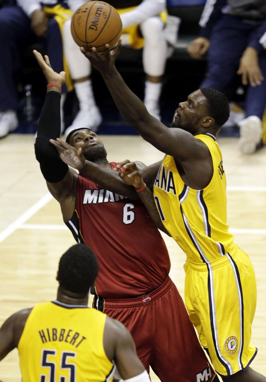 Indiana Pacers guard Lance Stephenson, right, shots over Miami Heat forward LeBron James during the first half of Game 1 of the Eastern Conference finals NBA basketball playoff series, Sunday, May 18, 2014, in Indianapolis. (AP Photo/AJ Mast)