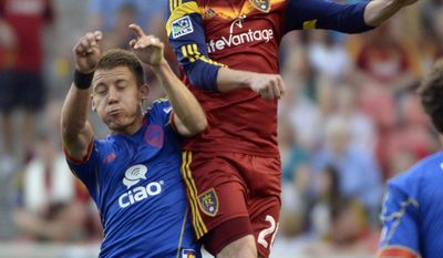 Real Salt Lake midfielder Ned Grabavoy (20) collides with Colorado Rapids midfielder Dillon Serna (17) during an MLS soccer game Saturday, May 17, 2014, in Sandy, Utah. (AP Photo/The Salt Lake Tribune, Rick Egan)  LOCAL TV OUT  MAGS OUT  DESERET NEWS OUT
