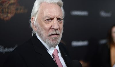 Actor Donald Sutherland poses for photographers as he arrives for the Hunger Games: Mockingjay - Part 1 party at the 67th international film festival, Cannes, southern France, Saturday, May 17, 2014. (Photo by Arthur Mola/Invision/AP)