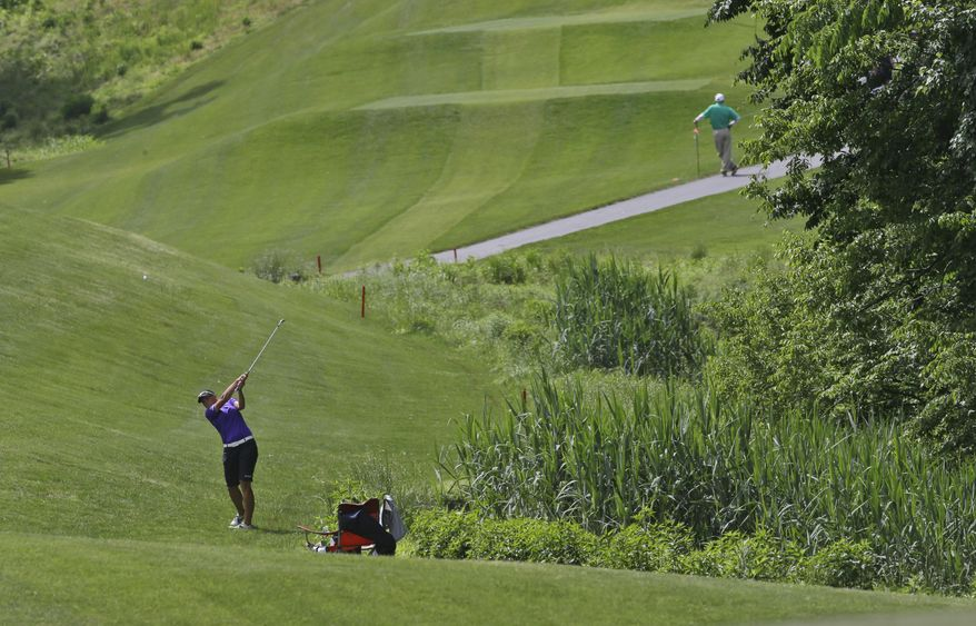 Katherine Kirk, of New Zealand, hits out of the fringe on the fourth hole during the final round of the Kingsmill Championship golf tournament at the Kingsmill resort  in Williamsburg, Va., Sunday, May 18, 2014.   (AP Photo/Steve Helber)