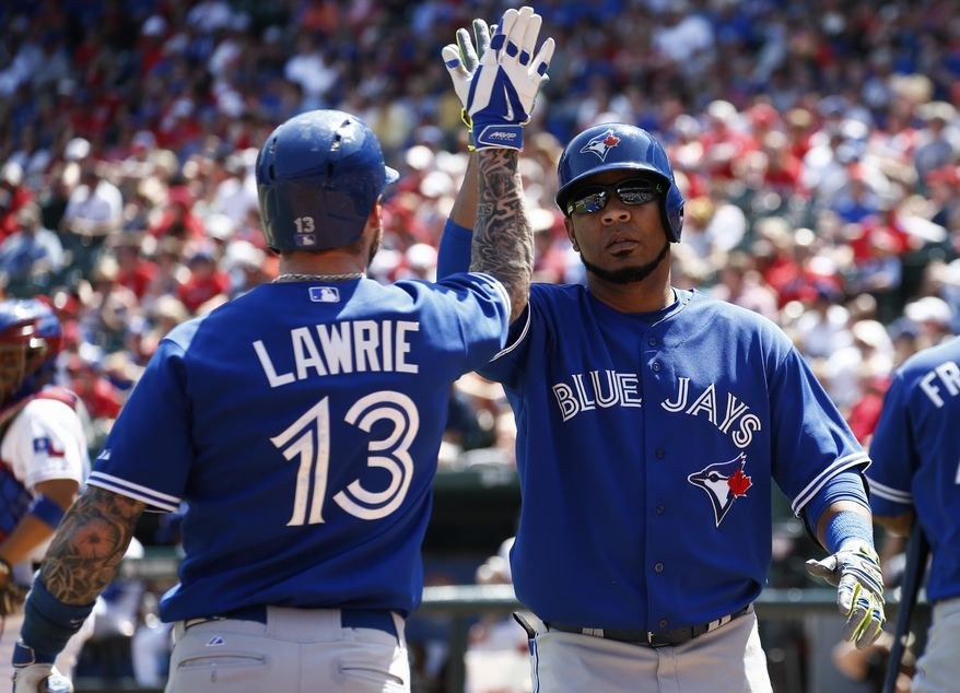 Toronto Blue Jays' Edwin Encarnacion, right, is congratulated by Brett Lawrie (13) after homering against the Texas Rangers during the sixth inning of a baseball game, Sunday, May 18, 2014, in Arlington, Texas. The Rangers won 6-2. (AP Photo/Jim Cowsert)