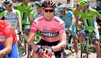 Overall leader Cadel Evans gets ready to start the 9th stage of the Giro d'Italia, Tour of Italy cycling race, from Lugo to Sestola, Italy, Sunday, May 18, 2014. (AP Photo/Gian Mattia D'Alberto)