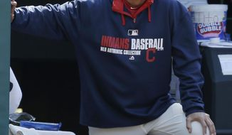 Cleveland Indians manager Terry Francona watches in the eighth inning of a baseball game against the Oakland Athletics, Sunday, May 18, 2014, in Cleveland. (AP Photo/Tony Dejak)