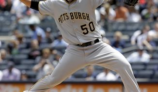 Pittsburgh Pirates starting pitcher Charlie Morton throws during the first inning of the first baseball game of a double-header against the New York Yankees at Yankee Stadium, Sunday, May 18, 2014 in New York. (AP Photo/Seth Wenig)