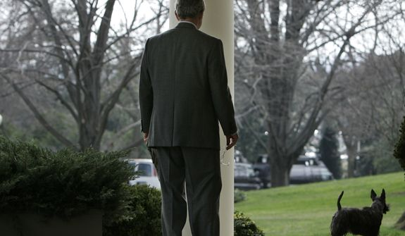 President Bush calls his dog Miss Beazley to come into the Oval Office of the White House in Washington, Wednesday, Jan. 24, 2007 prior to his meeting with Gen. Dan McNeill, incoming Commander for NATO's International Security Assistance Force in Afghanistan, not shown.  (AP Photo/Ron Edmonds)