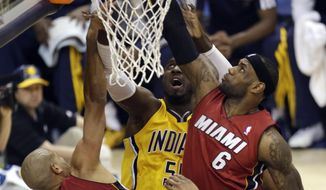 Miami Heat forward LeBron James (6) goes for a rebound in front of teammate Shane Battier (31) and Indiana Pacers center Roy Hibbert (55) and David West during the first half of Game 1 of the Eastern Conference finals NBA basketball playoff series Sunday, May 18, 2014, in Indianapolis. (AP Photo/AJ Mast)