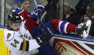 Edmonton Oil Kings' Blake Orban is checked into the boards by London Knights' Ryan Rupert during the first period action during the Memorial Cup CHL hockey tournament game in London, Ontario, on Sunday, May 18, 2014. (AP Photo/The Canadian Press, Dave Chidley)