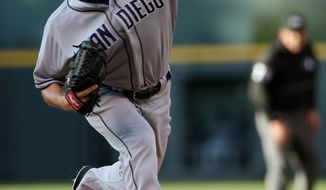San Diego Padres starting pitcher Robbie Erlin works against the Colorado Rockies in the first inning of a baseball game in Denver on Saturday, May 17, 2014. (AP Photo/David Zalubowski)