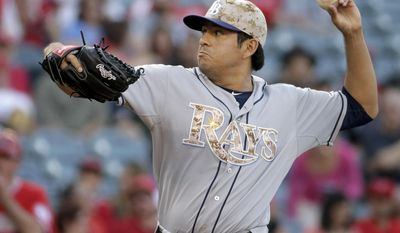 Tampa Bay Rays starting pitcher Cesar Ramos throws against the Los Angeles Angels during the first inning of a baseball game in Anaheim, Calif., Saturday, May 17, 2014. (AP Photo/Chris Carlson)