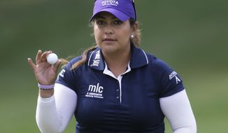 Lizette Salas tips her ball to the crowd on the ninth hole during the final round of the Kingsmill Championship golf tournament at the Kingsmill resort  in Williamsburg, Va., Sunday, May 18, 2014.  Salas birdied the par-3 hole.  (AP Photo/Steve Helber)