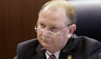 FILE - In this July 2, 2013 file photo, Alabama Public Service Commissioner Terry Dunn listens to a debate during a commission meeting in Montgomery, Ala. Dunn faces three opponents in the June 3, 2014 Republican primary. (AP Photo/Dave Martin)