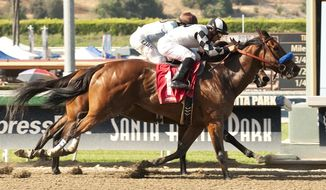 In this photo provided by Benoit Photo, Tommy Town Thoroughbreds' Let Faith Arise and jockey Corey Nakatani, outside, overpower Yahilwa (Kent Desormeaux), inside, to win the Grade III $100,000 Adoration Stakes horse race, Sunday, May 18, 2014, at Santa Anita Park in Arcadia Calif. (AP Photo/Benoit Photo)