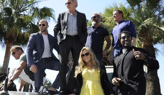 From left, Dolph Lundgren, Jason Statham, Harrison Ford, Mel Gibson, Sylvester Stallone, Wesley Snipes and Ronda Rousey during a photo call for The Expendables 3 at the 67th international film festival, Cannes, southern France, Sunday, May 18, 2014. (Photo by Arthur Mola/Invision/AP)