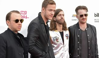 Ben McKee, from left, Dan Reynolds, Wayne Sermon and Daniel Platzman, of the musical group Imagine Dragons, arrive at the Billboard Music Awards at the MGM Grand Garden Arena on Sunday, May 18, 2014, in Las Vegas. (Photo by John Shearer/Invision/AP)