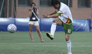 FILE- Inthis Sept. 5, 2013 file photo, Bolivia President Evo Morales kicks the ball during an exhibition soccer match in Bergamo, near Milan, Italy. A first-division Bolivian soccer club said May 18, 2014, that President Morales will suit up for the team and play about 20-30 minutes per match. Morales has not yet commented on the new gig, in which he's to receive minimum wage, or $213. (AP Photo/Antonio Calanni, File)