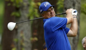 Kenny Perry watches his tee shot on the seventh hole during the final round at the Champions Tour Regions Tradition golf tournament on Sunday, May 18, 2014, in Birmingham, Ala. (AP Photo/Butch Dill)