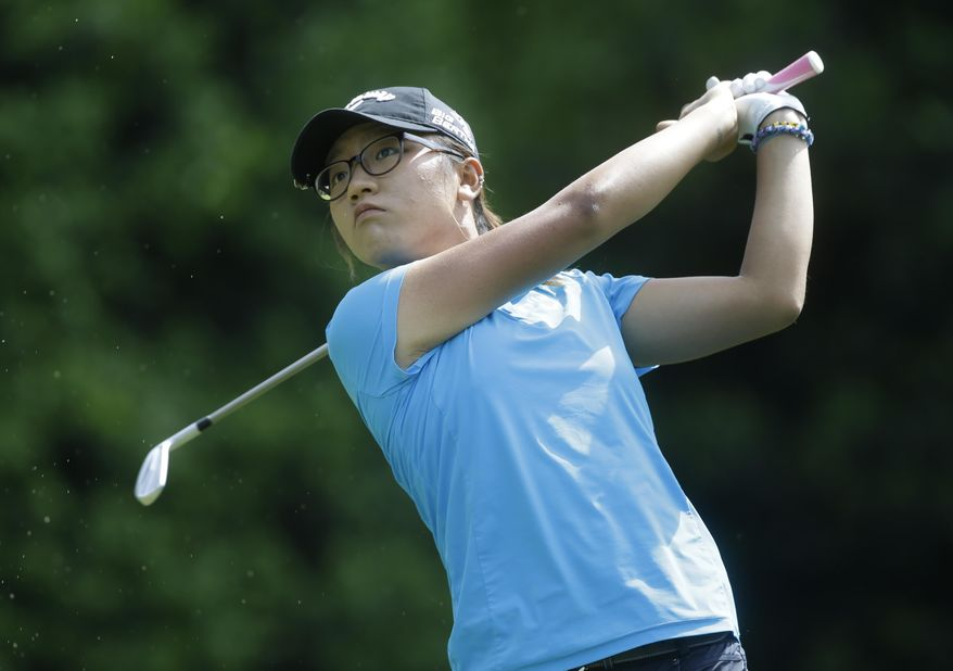 Lydia Ko, of New Zealand, watches her tee shot on the fifth hole during the final round of the Kingsmill Championship golf tournament at the Kingsmill resort  in Williamsburg, Va., Sunday, May 18, 2014.   (AP Photo/Steve Helber)
