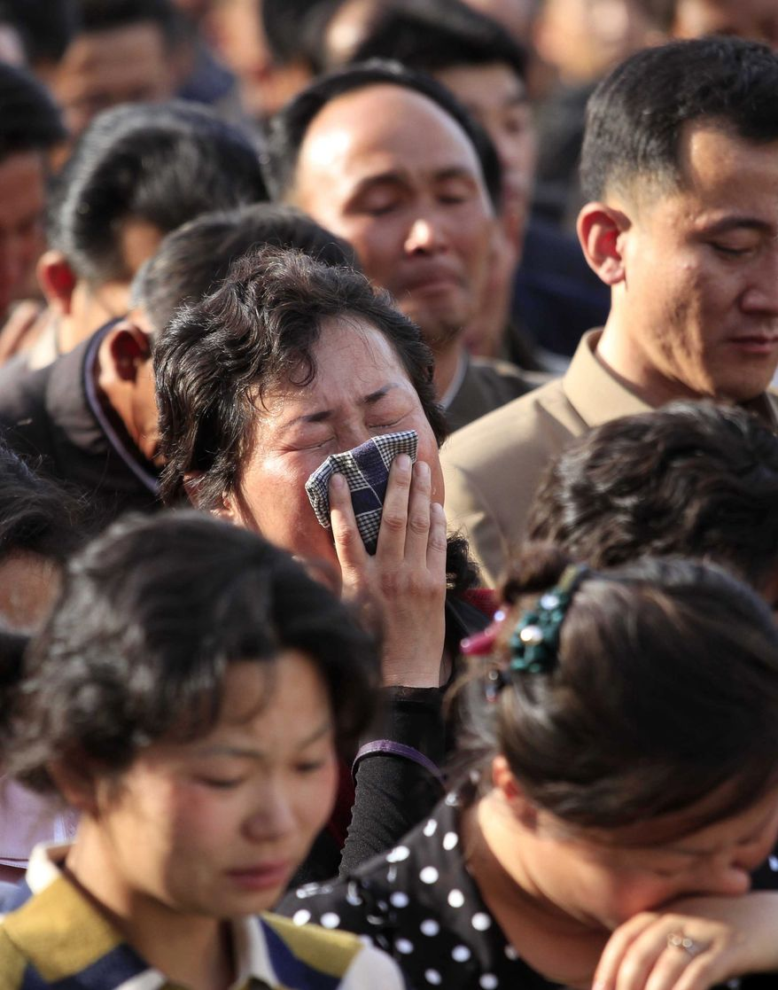 "In this Saturday, May 17, 2014 photo, families of victims of an accident at an apartment construction site in Pyongyang, North Korea, grieve during a gathering in the capital where senior officials apologized and took responsibility. The word of the collapse in the secretive nation's capital was reported Sunday morning, May 18 by the North's official Korean Central News Agency, which gave no death toll but said that the accident was ""serious"" and upset North Korea's leader, Kim Jong Un. (AP Photo/Jon Chol Jin)"