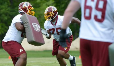 Washington Redskins draft pick Morgan Moses, center, participates in offensive line drills against Clint Marsh during rookie minicamp on Saturday, May 17 at Redskins Park in Ashburn.  Khalid Naji-Allah/ Special to The Washington Times