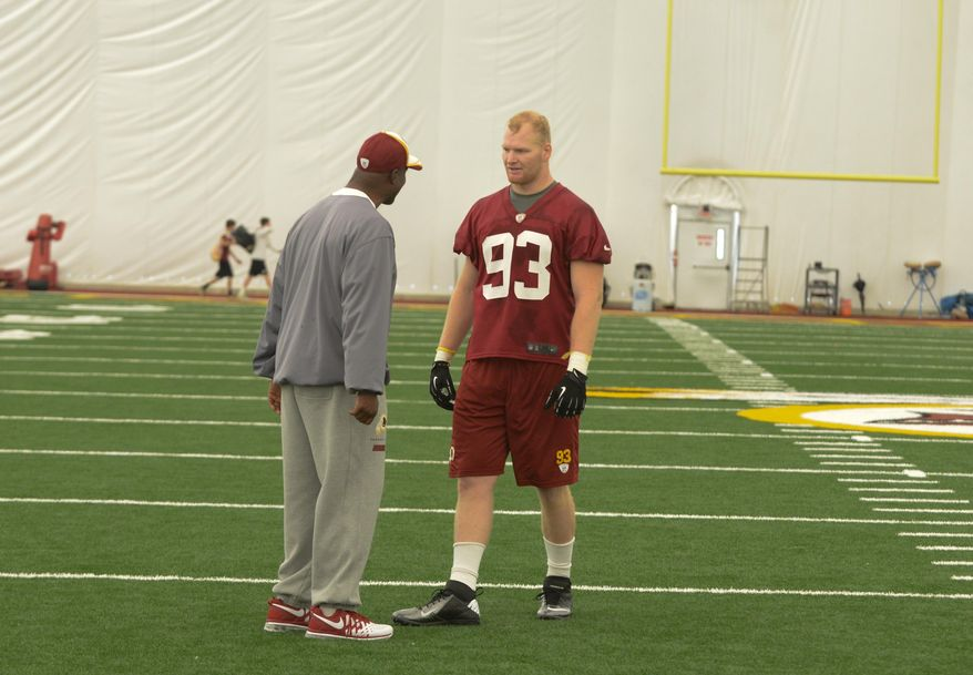 Washington Redskins Linebacker Draft Pick Trent Murphy (93) talks with a member of the Redskins coaching staff after a minicamp workout at Redskins Park in Ashburn on Saturday, May 17. Khalid Naji-Allah/ Special to The Washington Times