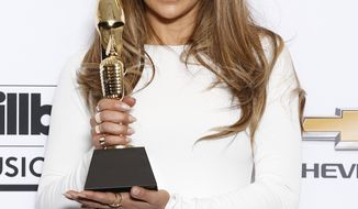 Jennifer Lopez poses in the press room with the icon award at the Billboard Music Awards at the MGM Grand Garden Arena on Sunday, May 18, 2014, in Las Vegas. (Photo by Eric Jamison/Invision/AP)