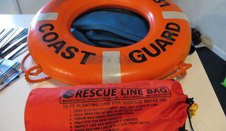 In a 2011 photo provided by the Michigan Sea Grant, a rescue line bag and ring buoy are seen from the Great Lakes Water Safety Conference 2011 in Gaylord, Mich. An effort to prevent people from drowning due to dangerous currents along the Great Lakes includes installing kits with life-saving aids including a ring buoy at 10 public beaches along Lake Michigan. Michigan Sea Grant announced Monday, May 19, 2014, that kits will be installed this summer. Additional support from the National Oceanic and Atmospheric Administration is expected to put similar equipment on beaches across the Great Lakes region over the next two years. (AP Photo/Michigan Sea Grant, Stephanie Ariganello)