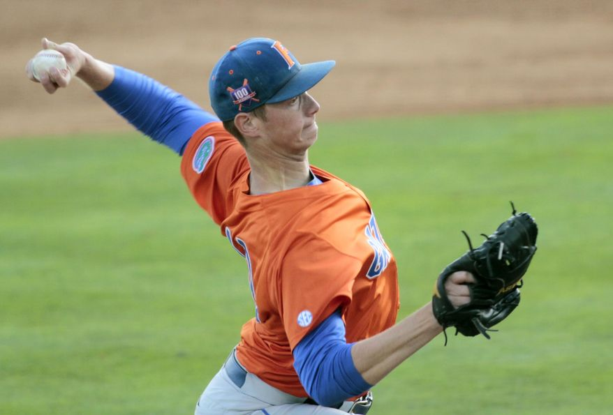 Florida's A. J. Puk throws a pitch against Tennessee during an NCAA college baseball game Friday, May 16, 2014 in Knoxville, Tenn. (AP Photo/The Daily Times, Daryl Sullivan)